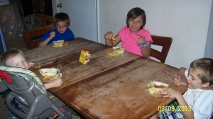 Here are the four children enjoying their  Manwiched Old El Paso Stand 'N Stuff® Soft Flour Tortillas dinners.