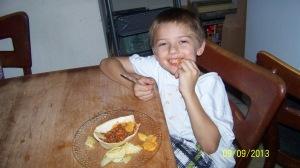 Here is Nickolaus enjoying his dinner